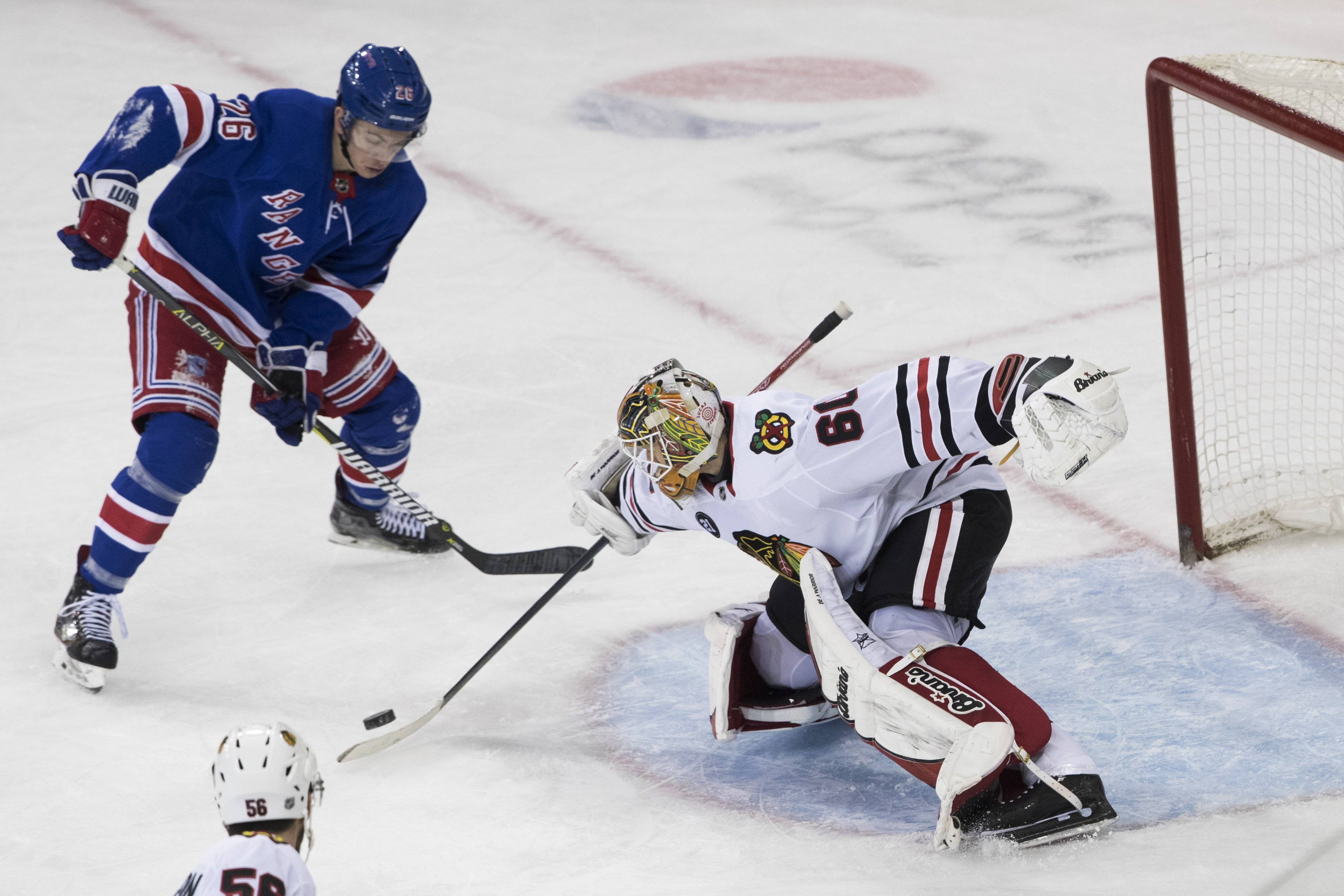 Chicago Blackhawks goaltender Collin Delia (60) makes a save against New York Rangers left wing Jimmy Vesey (26) during the third period of an NHL hockey game Thursday, Jan. 17, 2019, at Madison Square Garden in New York. The Rangers won 4-3.