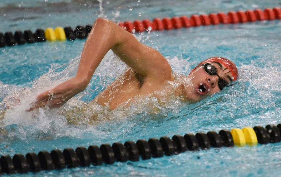 Palatine's Christian Snyder swims the 200-yard freestyle event Thursday in Barrington.
