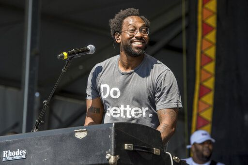 FILE - In this May 5, 2017 file photo, PJ Morton performs at the New Orleans Jazz and Heritage Festival in New Orleans. Morton is set to perform at next month's Super Bowl halftime show as a member of Maroon 5, and a week later he'll attend the Grammy Awards, where he's nominated for four awards, including three for his work as a R&B singer. (Photo by Amy Harris/Invision/AP, File)