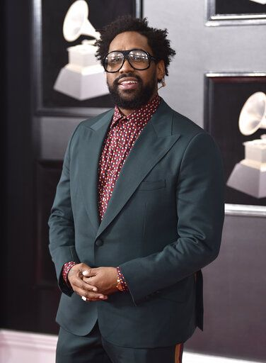FILE - In this Jan. 28, 2018 file photo, PJ Morton of Maroon 5 arrives at the 60th annual Grammy Awards in New York. Morton is set to perform at next month's Super Bowl halftime show as a member of Maroon 5, and a week later he'll attend the Grammy Awards, where he's nominated for four awards, including three for his work as a R&B singer. (Photo by Evan Agostini/Invision/AP, File)
