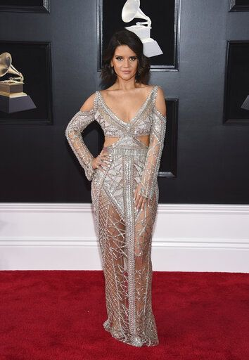 "FILE - In this Jan. 28, 2018 file photo, Maren Morris arrives at the 60th annual Grammy Awards in New York. Morris is nominated in both country, pop and all-genre categories this year, including two nominations in the country genre categories for ""Dear Hate,� a duet with Vince Gill released after the Las Vegas mass shooting, and a nomination for ""Mona Lisas and Mad Hatters,� a cover from an Elton John tribute album. Her song ""The Middle"" with EDM artists Zedd and Grey, is nominated for record and song of the year at this year's Grammy Awards on Feb. 10, and Morris was also nominated for best pop duo/group collaboration. (Photo by Evan Agostini/Invision/AP, File)"
