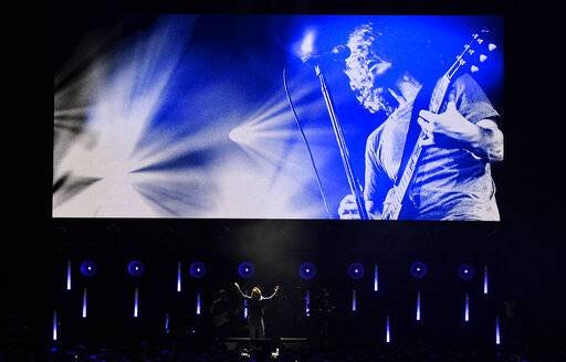 "Singer Brandi Carlisle performs underneath an image of the late singer Chris Cornell during ""I Am The Highway: A Tribute to Chris Cornell"" at The Forum, Wednesday, Jan. 16, 2019, in Inglewood, Calif. (Photo by Chris Pizzello/Invision/AP)"