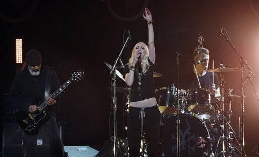"Singer Taylor Momsen, center, performs with Soundgarden members Kim Thayil, left, and Matt Cameron during ""I Am The Highway: A Tribute to Chris Cornell"" at The Forum, Wednesday, Jan. 16, 2019, in Inglewood, Calif. (Photo by Chris Pizzello/Invision/AP)"