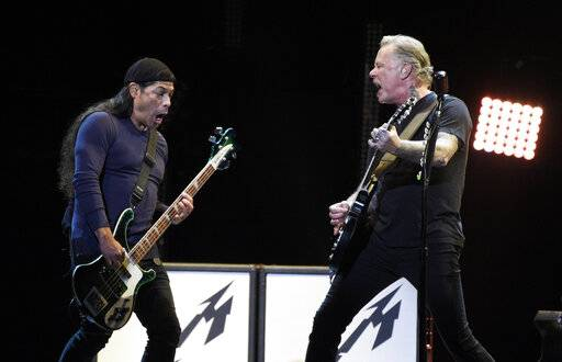 "Robert Trujillo, left, and James Hetfield of Metallica perform during ""I Am The Highway: A Tribute to Chris Cornell"" at The Forum, Wednesday, Jan. 16, 2019, in Inglewood, Calif. (Photo by Chris Pizzello/Invision/AP)"