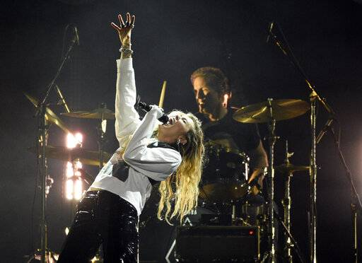"Singer Miley Cyrus performs during ""I Am The Highway: A Tribute to Chris Cornell"" at The Forum, Wednesday, Jan. 16, 2019, in Inglewood, Calif. (Photo by Chris Pizzello/Invision/AP)"