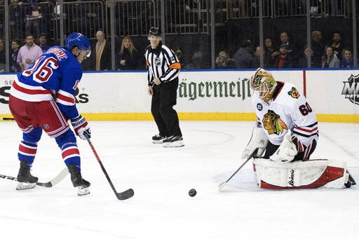Chicago Blackhawks goaltender Collin Delia (60) makes a save against New York Rangers center Ryan Strome (16) during the second period of an NHL hockey game Thursday, Jan. 17, 2019, at Madison Square Garden in New York.