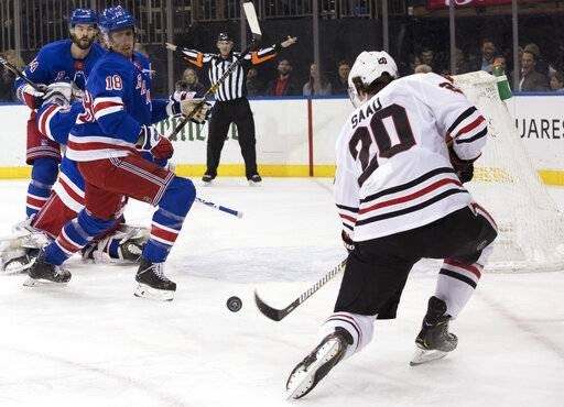 Chicago Blackhawks left wing Brandon Saad (20) shoots for a goal past New York Rangers defenseman Marc Staal (18) during the first period of an NHL hockey game Thursday, Jan. 17, 2019, at Madison Square Garden in New York.