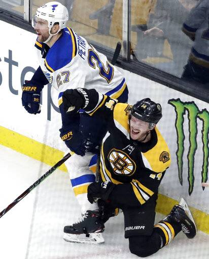 Boston Bruins right wing Chris Wagner (14) celebrates his goal next to St. Louis Blues defenseman Alex Pietrangelo (27) during the third period of an NHL hockey game Thursday, Jan. 17, 2019, in Boston.