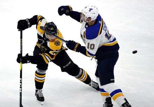 Boston Bruins left wing Peter Cehlarik (22) and St. Louis Blues center Brayden Schenn (10) compete for the puck during the first period of an NHL hockey game Thursday, Jan. 17, 2019, in Boston.