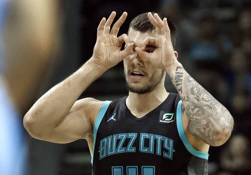 Charlotte Hornets' Willy Hernangomez gestures after making a 3-point basket against the Sacramento Kings during the first half of an NBA basketball game in Charlotte, N.C., Thursday, Jan. 17, 2019.