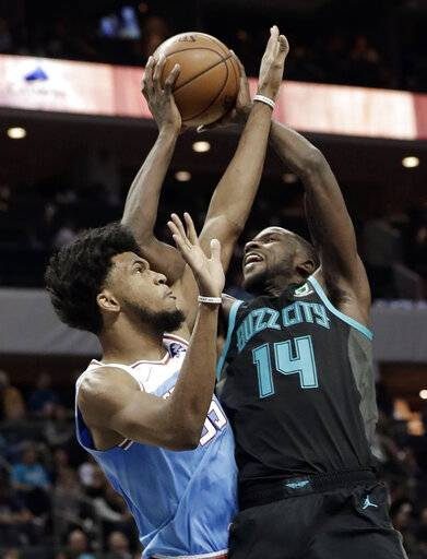 Charlotte Hornets' Michael Kidd-Gilchrist (14) shoots against Sacramento Kings' Marvin Bagley III (35) during the first half of an NBA basketball game in Charlotte, N.C., Thursday, Jan. 17, 2019.