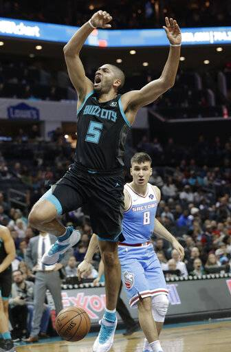 Charlotte Hornets' Nicolas Batum (5) loses the ball as he drives past Sacramento Kings' Bogdan Bogdanovic (8) during the first half of an NBA basketball game in Charlotte, N.C., Thursday, Jan. 17, 2019.