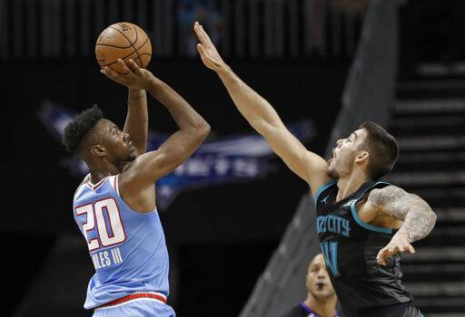 Sacramento Kings' Harry Giles (20) shoots over Charlotte Hornets' Willy Hernangomez (41) during the first half of an NBA basketball game in Charlotte, N.C., Thursday, Jan. 17, 2019.