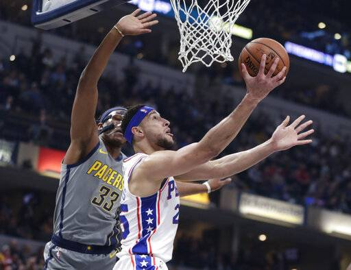 Philadelphia 76ers guard Ben Simmons (25) shoots next to Indiana Pacers center Myles Turner (33) during the first half of an NBA basketball game in Indianapolis, Thursday, Jan. 17, 2019.
