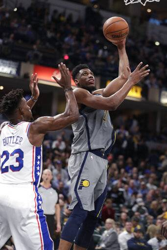 Indiana Pacers forward Thaddeus Young (21) shoots next to Philadelphia 76ers guard Jimmy Butler (23) during the second half of an NBA basketball game in Indianapolis, Thursday, Jan. 17, 2019. The 76ers won 120-96.
