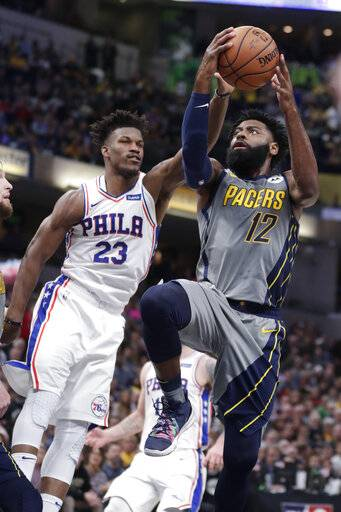 Indiana Pacers guard Tyreke Evans (12) shoots in front of Philadelphia 76ers guard Jimmy Butler (23) during the second half of an NBA basketball game in Indianapolis, Thursday, Jan. 17, 2019. The 76ers defeated the Pacers 120-96.