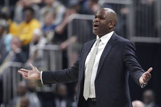 Indiana Pacers coach Nate McMillan questions a call during the first half of the team's NBA basketball game against the Philadelphia 76ers in Indianapolis, Thursday, Jan. 17, 2019.