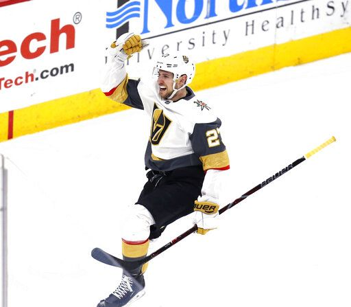 Vegas Golden Knights defenseman Shea Theodore (27) celebrates after his goal against the Chicago Blackhawks during the overtime period of an NHL hockey game Saturday, Jan. 12, 2019, in Chicago.