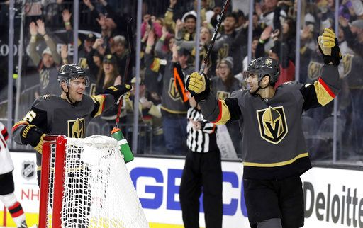 Vegas Golden Knights left wing Max Pacioretty, right, and center Paul Stastny celebrate after Pacioretty's goal against the New Jersey Devils during the second period of an NHL hockey game Sunday, Jan. 6, 2019, in Las Vegas.