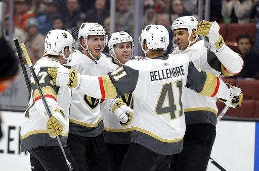 Vegas Golden Knights' Nate Schmidt, second from left, celebrates his goal with teammates during the first period of an NHL hockey game against the Anaheim Ducks on Friday, Jan. 4, 2019, in Anaheim, Calif.