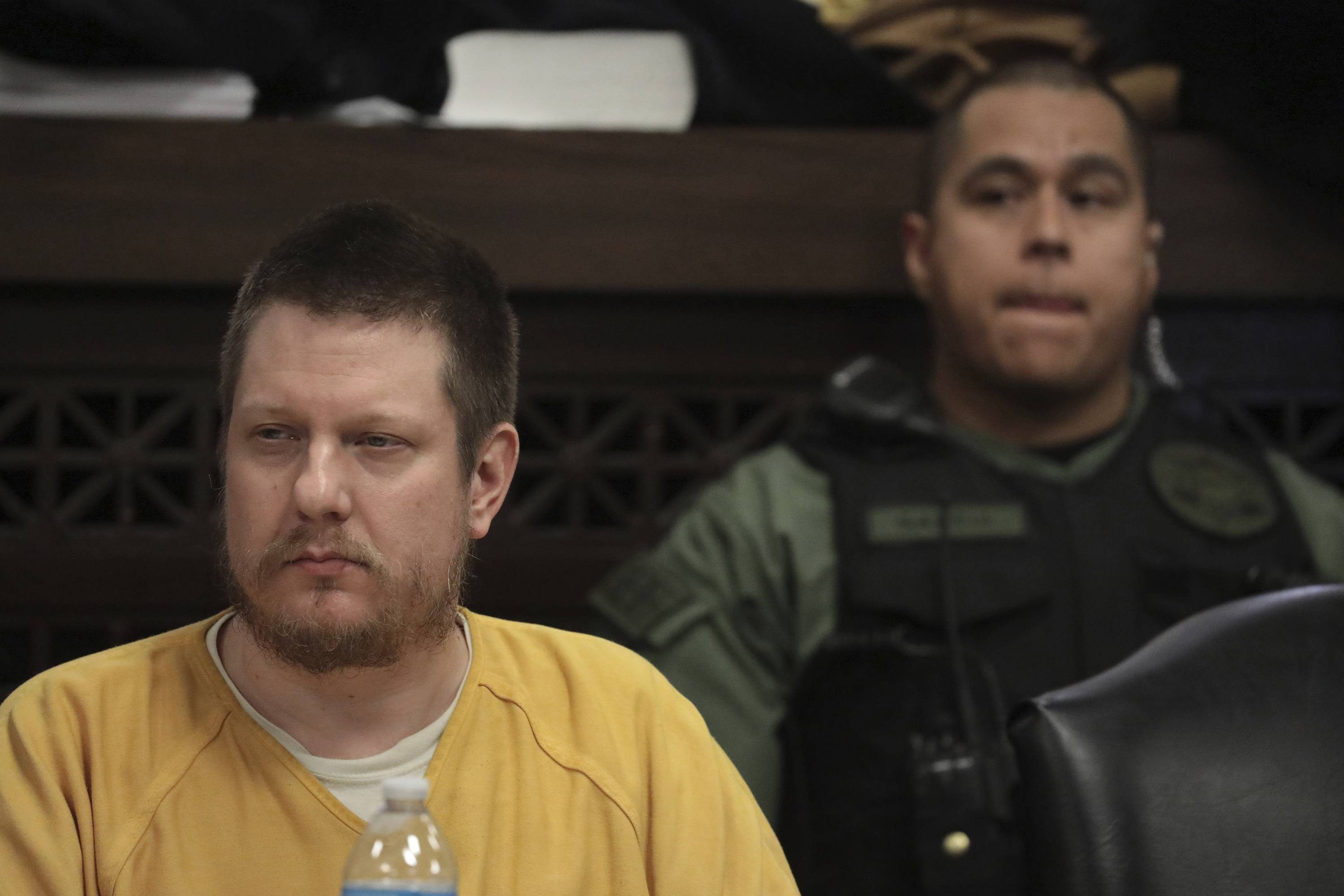 Former Chicago police officer Jason Van Dyke awaits his sentence Friday at the Leighton Criminal Court Building in Chicago. Van Dyke was convicted last year of second-degree murder and 16 counts of aggravated battery -- one for each bullet fired at Laquan McDonald.
