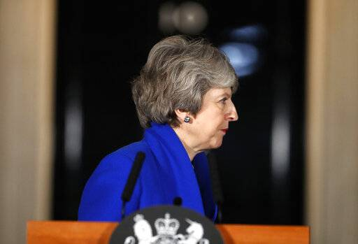 British Prime Minister Theresa May turns away after speaking outside 10 Downing street in London, Wednesday, Jan. 16, 2019. May's government survived a no-confidence vote Wednesday called after May's Brexit deal was overwhelmingly rejected by lawmakers.