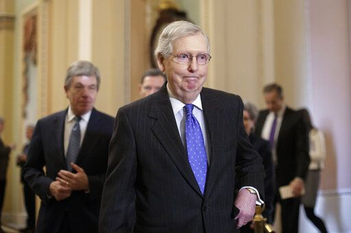 "In this Jan. 15, 2019, photo, Senate Majority Leader Mitch McConnell, R-Ky., arrives to speak to reporters following a weekly policy meeting on Capitol Hill in Washington. One of McConnell's guiding principles is: ""There's no education in the second kick of a mule.� Now, deep in a government shutdown he wanted President Donald Trump to avoid, McConnell is not about to be kicked again."