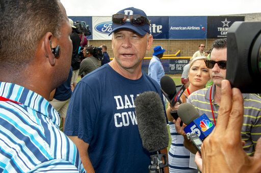 FILE - In this July 28, 2018, file photo, Dallas Cowboys offensive coordinator Scott Linehan talks with the media after morning practice at NFL football training camp, in Oxnard, Calif. Scott Linehan is out as offensive coordinator of the Dallas Cowboys only days after coach Jason Garrett sent mixed messages about the oft-criticized assistant's future. Garrett said in a statement released by the team Friday, Jan. 18, 2019, that he and Linehan had some open discussions this week and mutually agreed that a change was needed after five seasons.