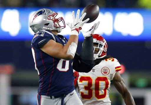 FILE - In this Sunday, Oct. 14, 2018, file photo, New England Patriots tight end Rob Gronkowski, left, catches a pass in front of Kansas City Chiefs safety Josh Shaw (30) during the second half of an NFL football game in Foxborough, Mass.