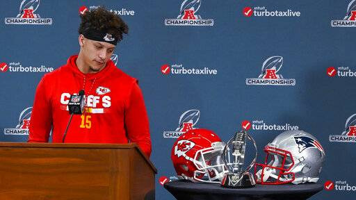 Kansas City Chiefs quarterback Patrick Mahomes looks at the Lamar Hunt Trophy during a news conference Wednesday, Jan. 16, 2019, in Kansas City, Mo. The Chiefs are scheduled to play the New England Patriots for the NFL football AFC championship Sunday. (John Sleezer/The Kansas City Star via AP)