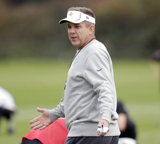 FILE - In this Sept. 29, 2017, file photo, New Orleans Saints head coach Sean Payton supervises the stretching session of an NFL training session, in London. From the first day of training camp in August until deep into the NFL schedule, you hear it. Doesn't matter what city a team represents or who is coaching and playing for it, the bromide is the same. Win the division.