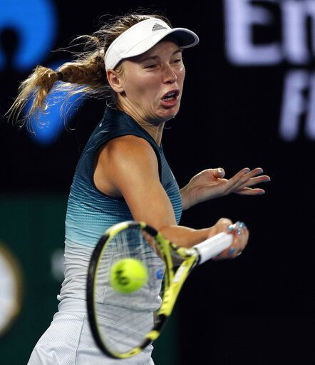 Denmark's Caroline Wozniacki makes a forehand return to Russia's Maria Sharapova during their third round match at the Australian Open tennis championships in Melbourne, Australia, Friday, Jan. 18, 2019.
