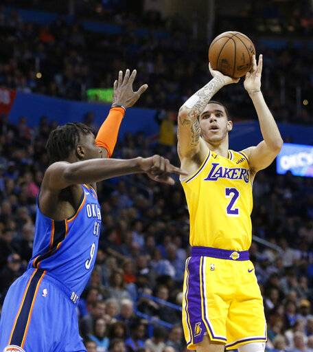 Los Angeles Lakers guard Lonzo Ball (2) shoots as Oklahoma City Thunder forward Jerami Grant defends during the first half of an NBA basketball game in Oklahoma City, Thursday, Jan. 17, 2019.