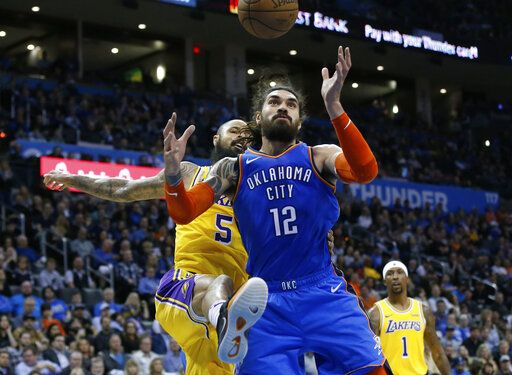 Oklahoma City Thunder center Steven Adams (12) reaches for a rebound in front of Los Angeles Lakers center Tyson Chandler (5) during the first half of an NBA basketball game in Oklahoma City, Thursday, Jan. 17, 2019.
