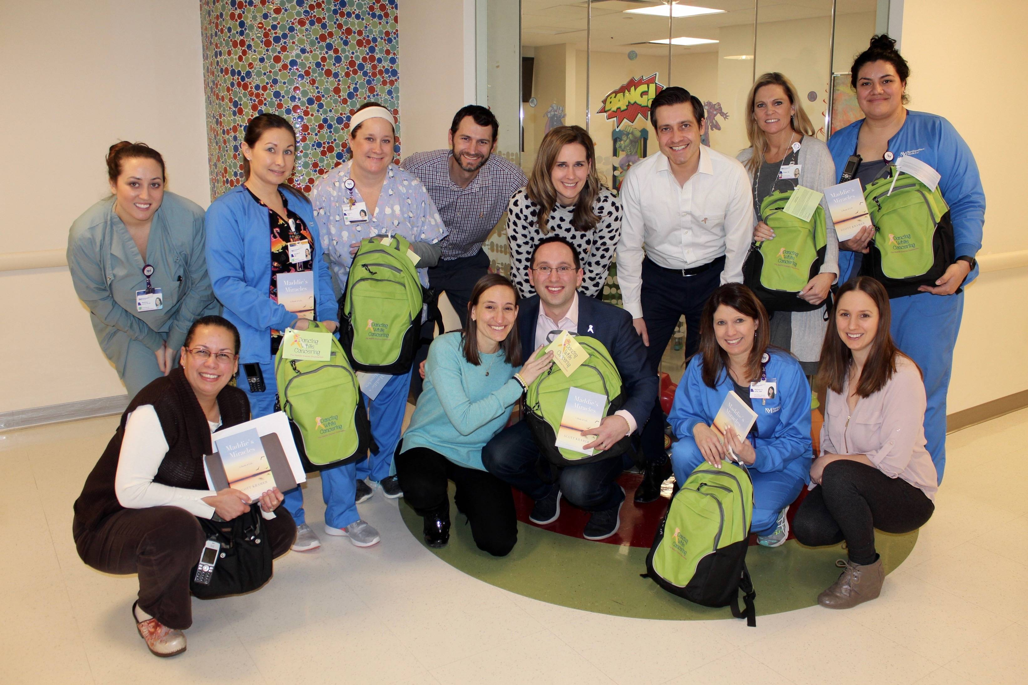 Scott and Pammy Kramer, center, donate Smile Packs to children at partner hospitals, including Lurie Children's at Northwestern Medicine Central DuPage Hospital in Winfield, Illinois, where pediatric hematologists/oncologists diagnose and treat children with blood diseases and cancer.