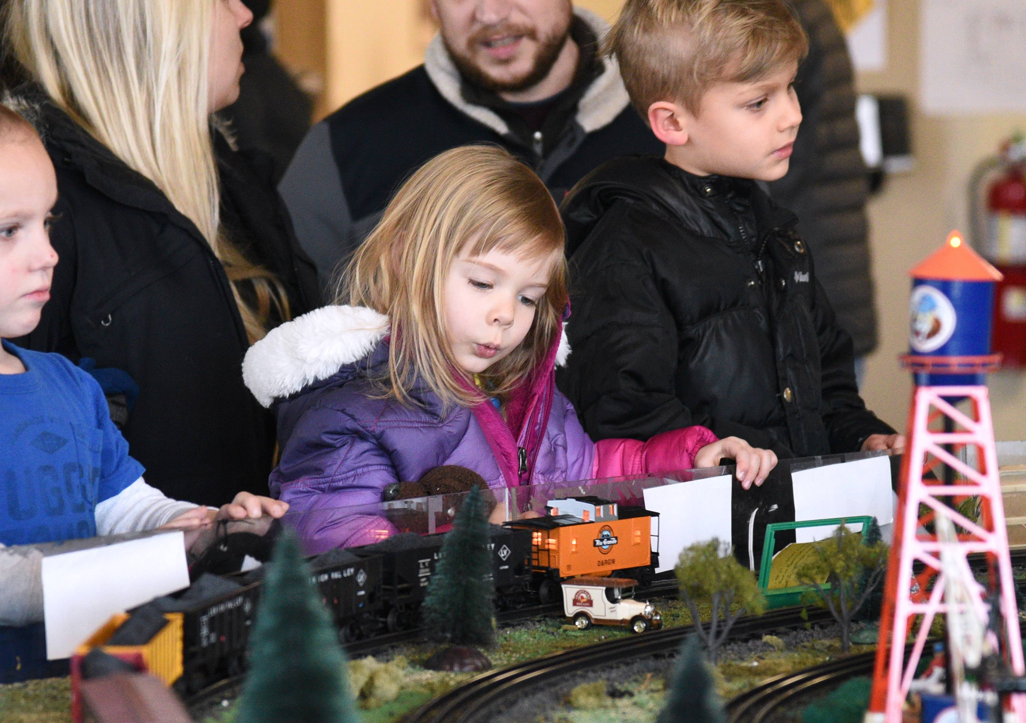 Maya Hurvitz, 3, of Libertyville, and Jackson Lasik, 4, of Lake Bluff, right, get a close look at the trains during the North Central 'O' Gaugers Model Railroad Club monthly run at the Fremont Public Library in Mundelein.