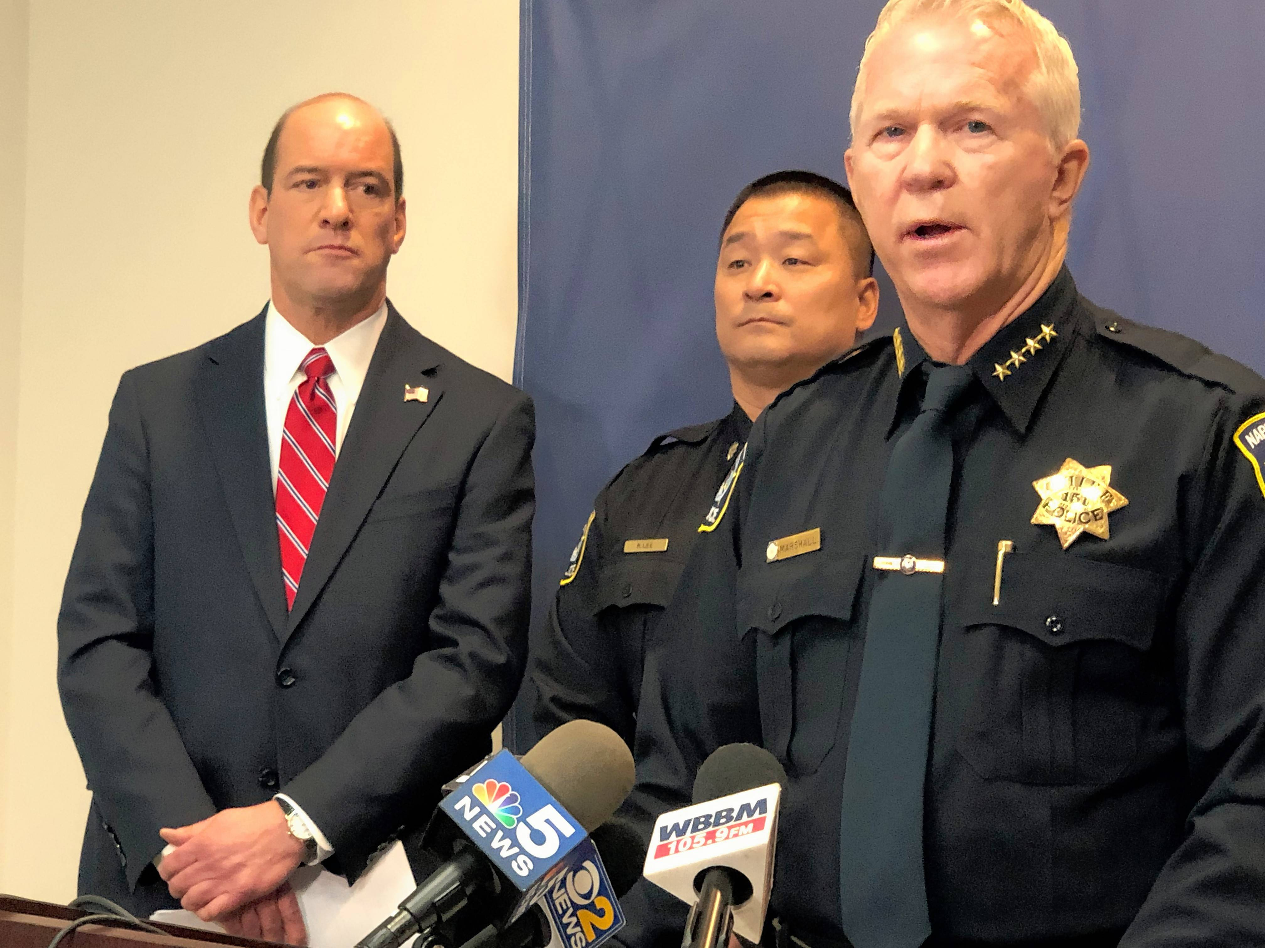 Naperville Police Chief Robert Marshall, right, and DuPage County State's Attorney Robert Berlin, left, address the media after a Rockford man, his girlfriend and his mother were charged with murder in the death of a Naperville man whose body was found months later in a trash bin on the South Side of Chicago.