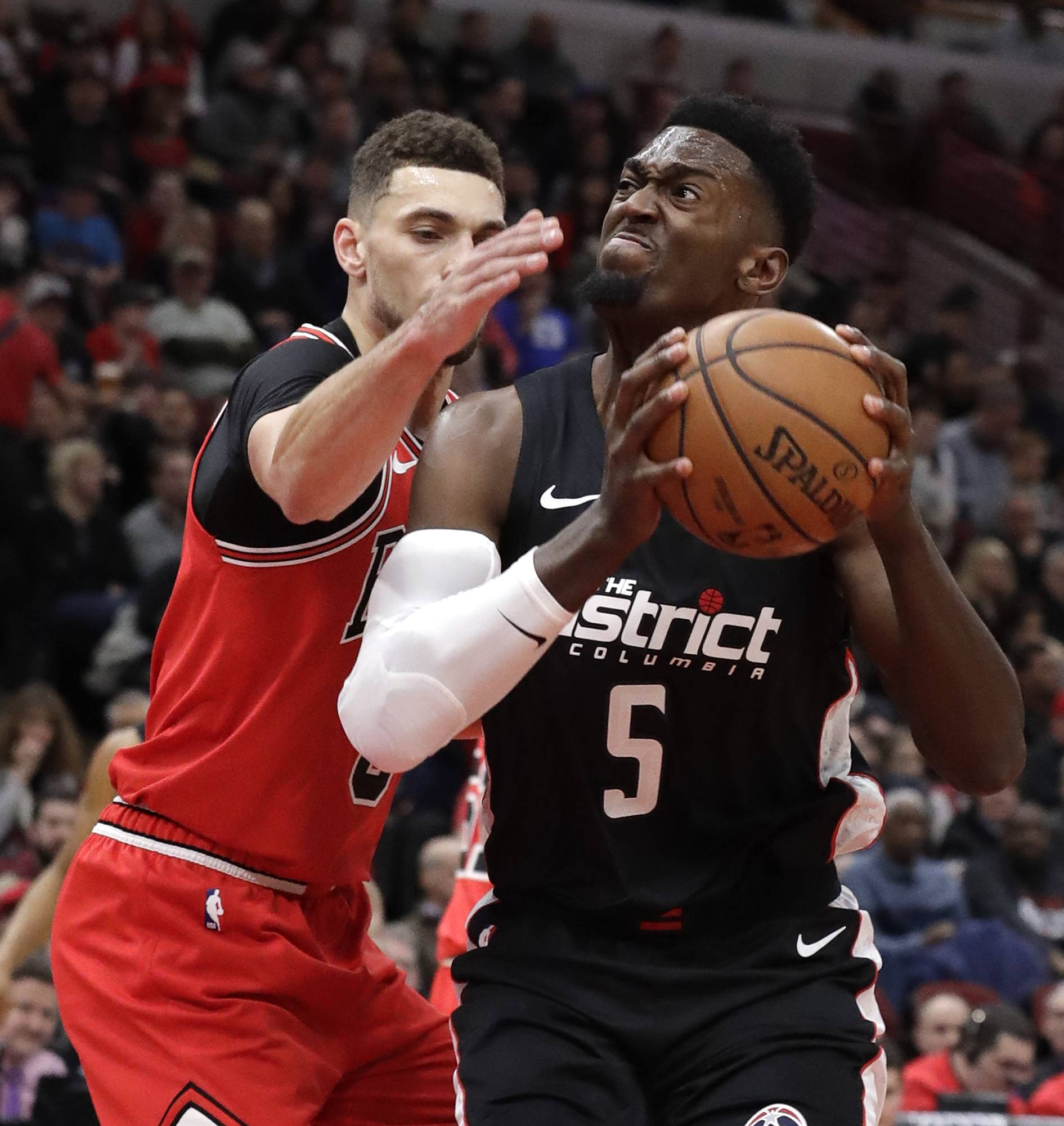 Washington Wizards forward Bobby Portis, right, drives to the basket against Chicago Bulls guard Zach LaVine during the first half of an NBA basketball game Saturday, Feb. 9, 2019, in Chicago.