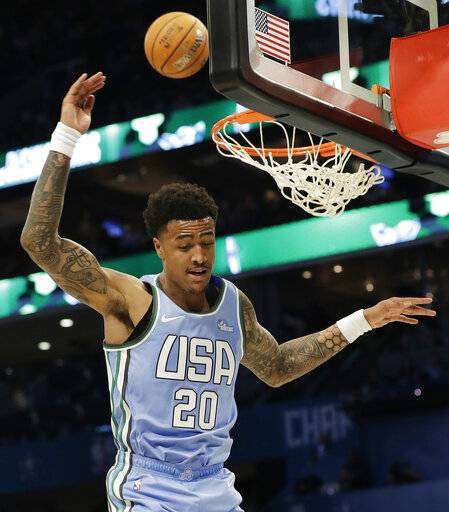 U.S. Team's John Collins, of the Atlanta Hawks misses the dunk against the World Team during the NBA All-Star Rising Stars basketball game, Friday, Feb. 15, 2019, in Charlotte, N.C.