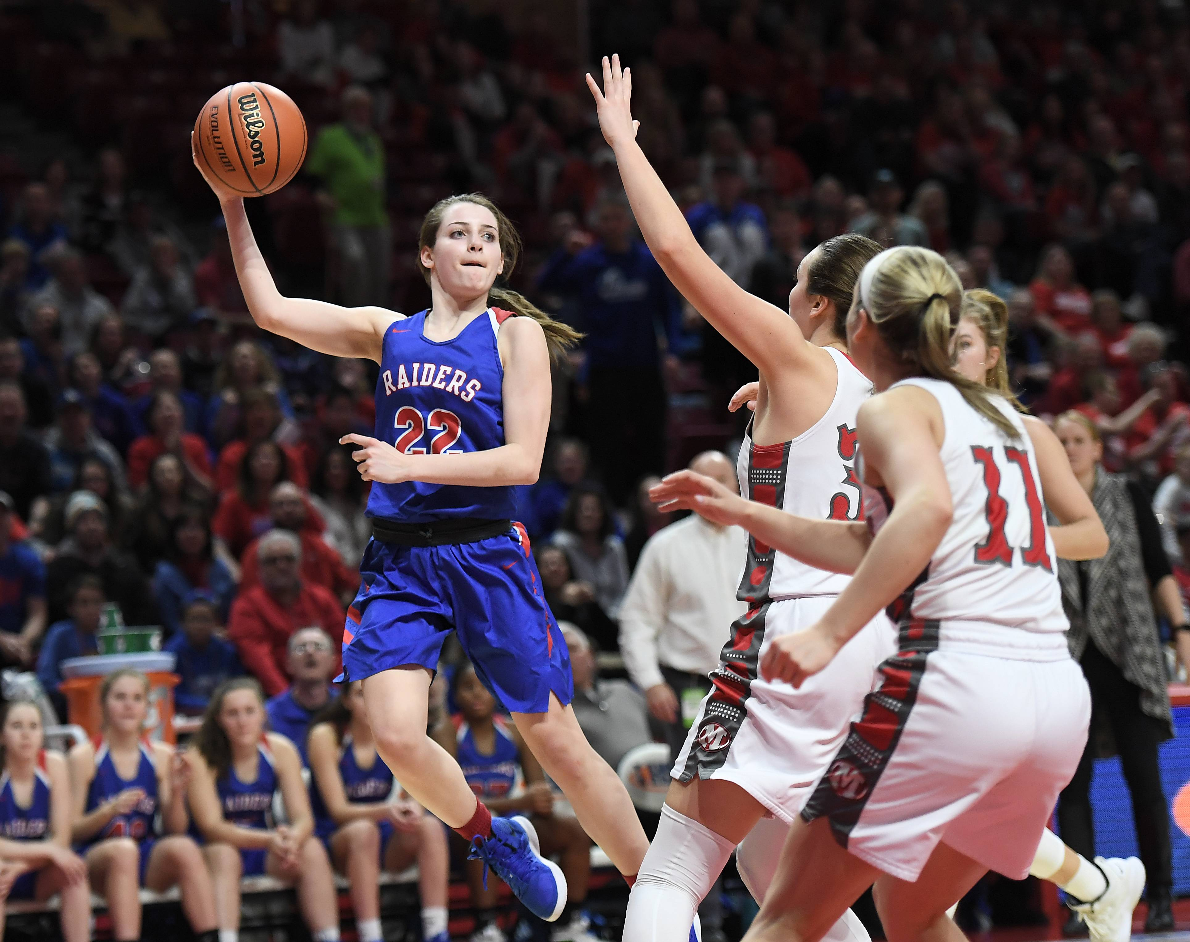 Glenbard South's Raquel LaPonte goes airborne to pass under pressure to a teammate in the IHSA girls state basketball Class 3A finals in Normal on Friday. Glenbard South ended up losing to Morton 35-21.