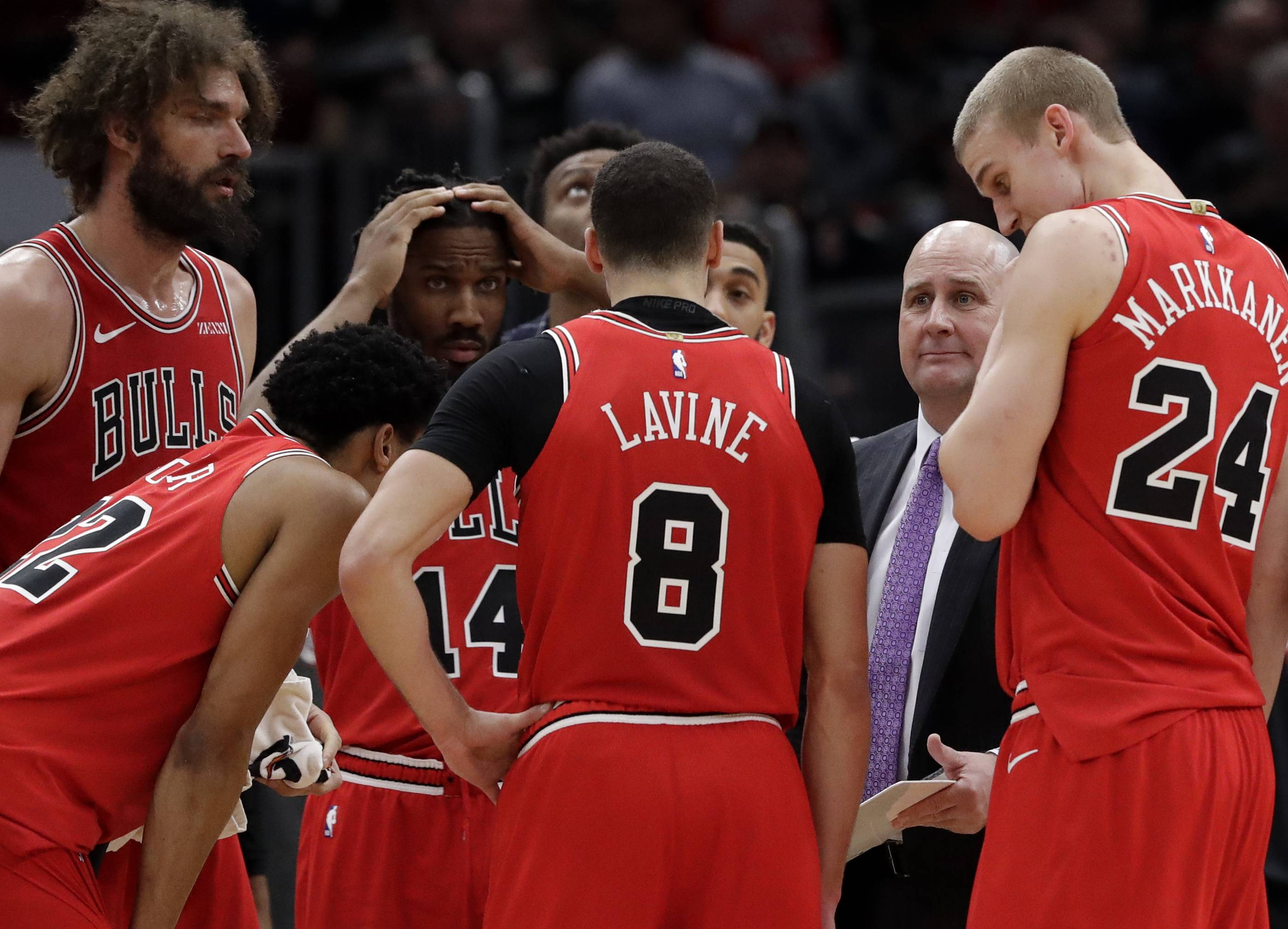 Chicago Bulls coach Jim Boylen, second from right, talks to his team during the second half of an NBA basketball game against the Detroit Pistons, Friday, March 8, 2019, in Chicago. The Pistons won 112-104.