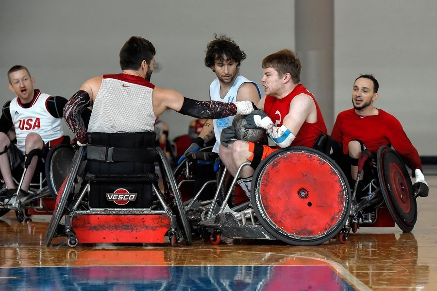Kevin Hamilton of Arlington Heights, second from right, who plays wheelchair basketball for the University of Illinois team, was one of 42 players to try out for Team USA wheelchair rugby.