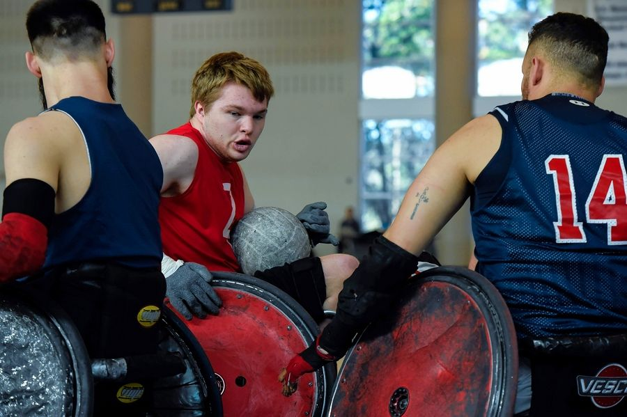 Wheelchair rugby is intensely physical, as seen here, with players trying to steal the ball.