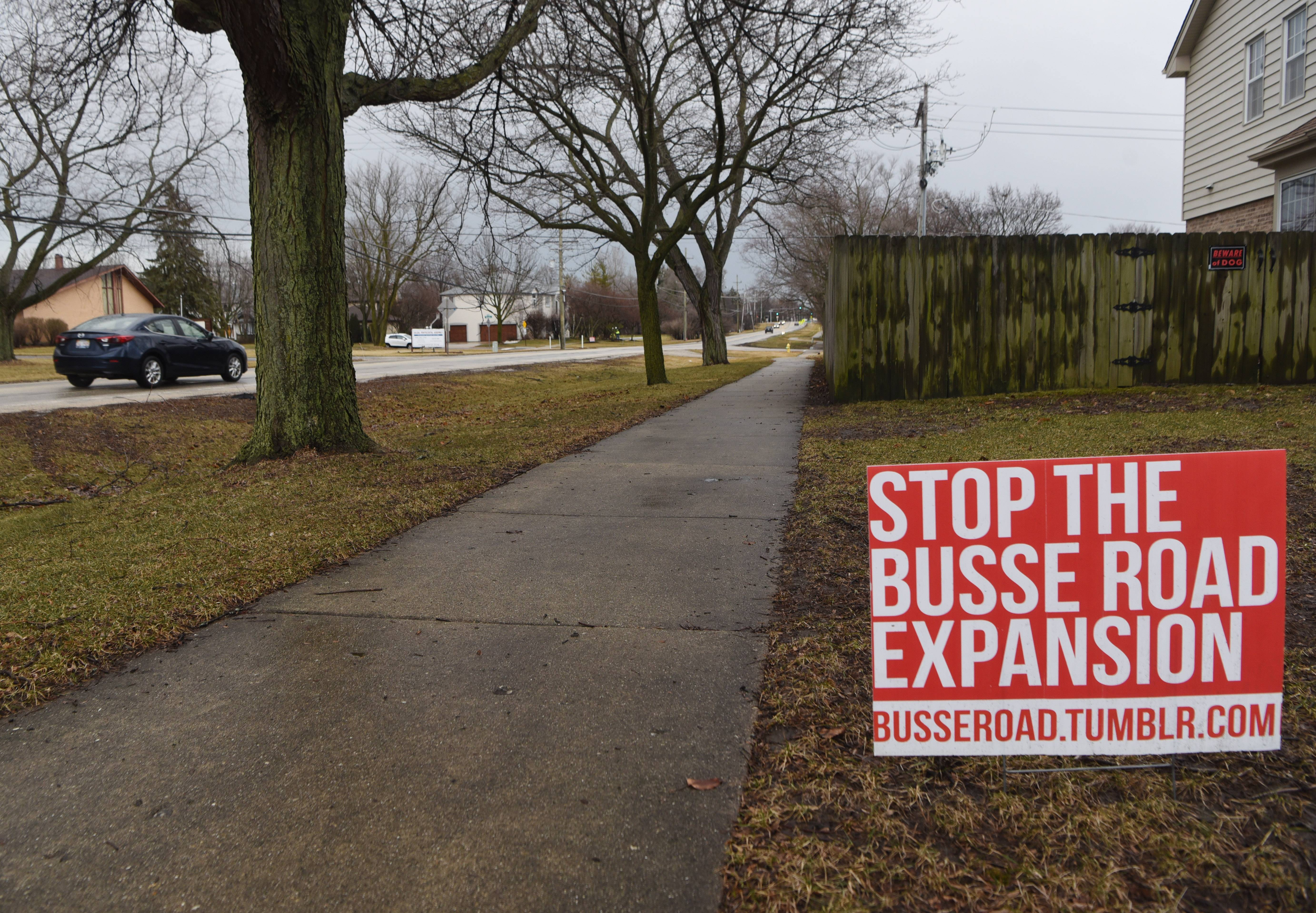 Although some see it as a lost cause, residents along Busse Road in Mount Prospect say they'll continue to oppose Cook County plans to widen the two-lane thoroughfare between Central and Golf roads and add sidewalks and curbs.
