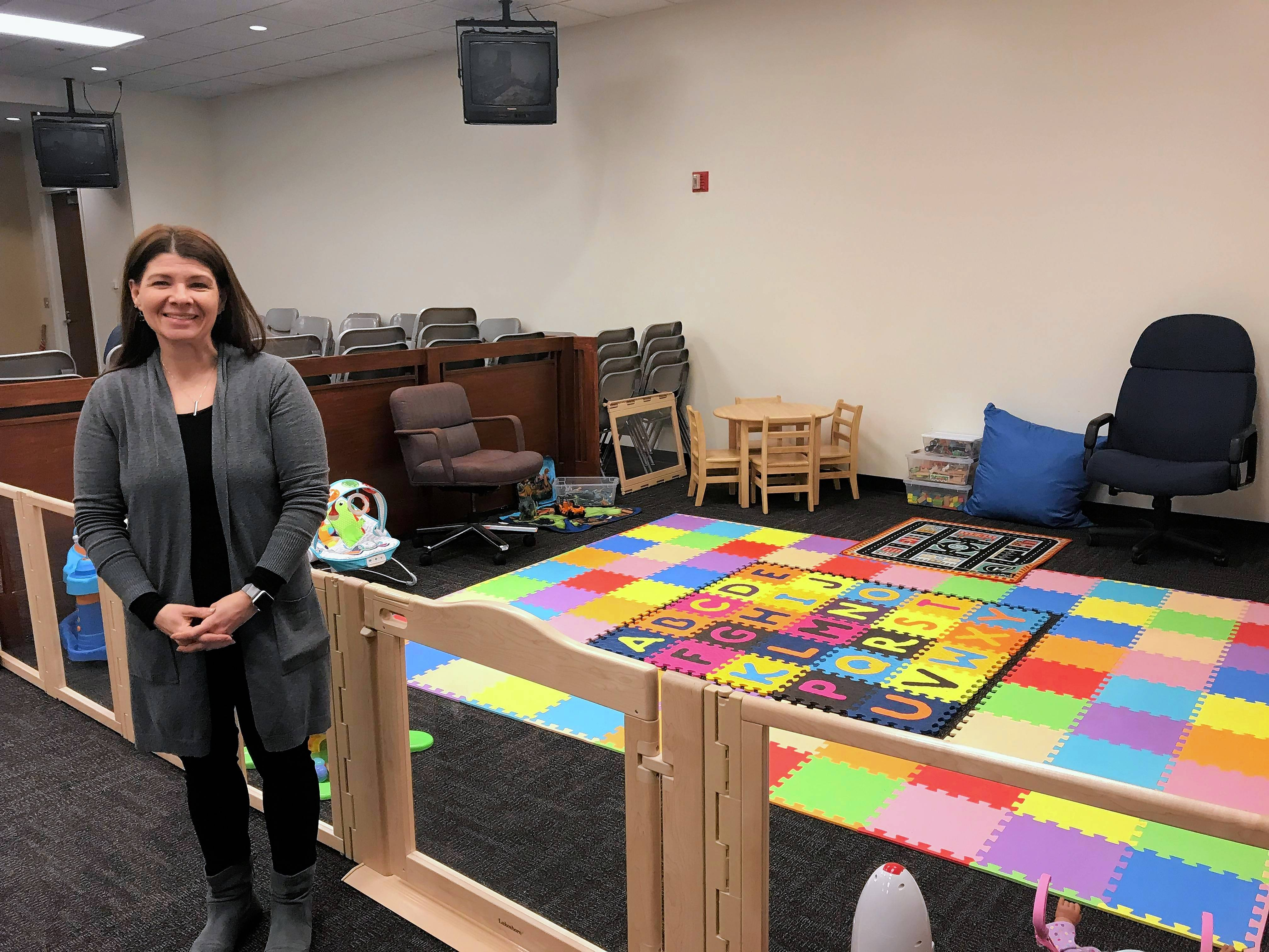Ann Lobb, director of the Children's Waiting Room at the Kane County Judicial Center, in the waiting room's temporary home in a courtroom. Its usual space was damaged by a flood from a broken sprinkler.