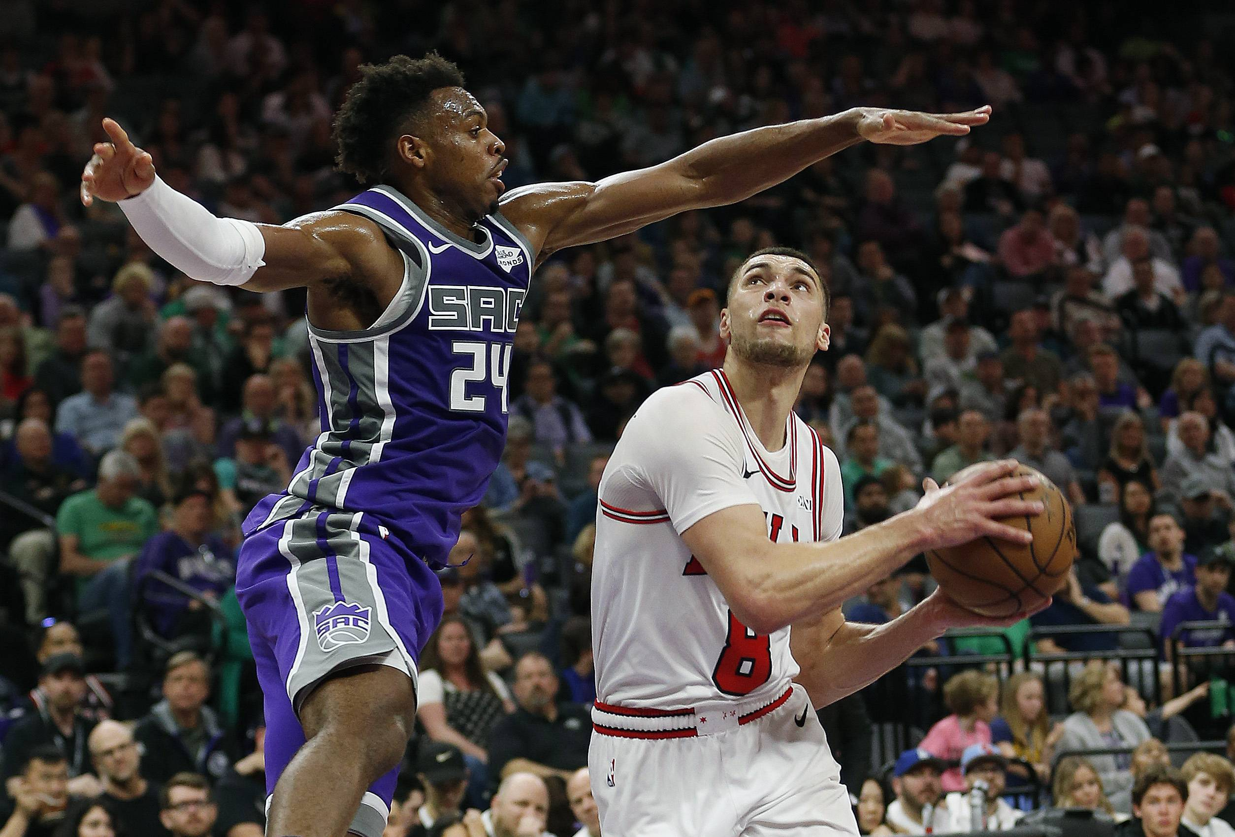 Chicago Bulls guard Zach LaVine, right drives to the basket against Sacramento Kings guard Buddy Hield during the second half of an NBA basketball game Sunday, March 17, 2019, in Sacramento, Calif. The Kings won 129-102. (AP Photo/Rich Pedroncelli)
