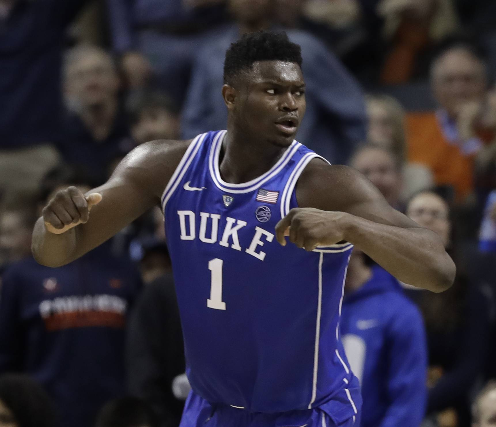 Duke's Zion Williamson (1) reacts after scoring against North Carolina during the second half of an NCAA college basketball game in the Atlantic Coast Conference tournament in Charlotte, N.C., Friday, March 15, 2019. (AP Photo/Chuck Burton)