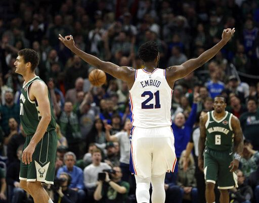 Philadelphia 76ers' Joel Embiid (21) reacts after making a shot during the second half of the team's NBA basketball game against the Milwaukee Bucks on Sunday, March 17, 2019, in Milwaukee. The 76ers won 130-125.