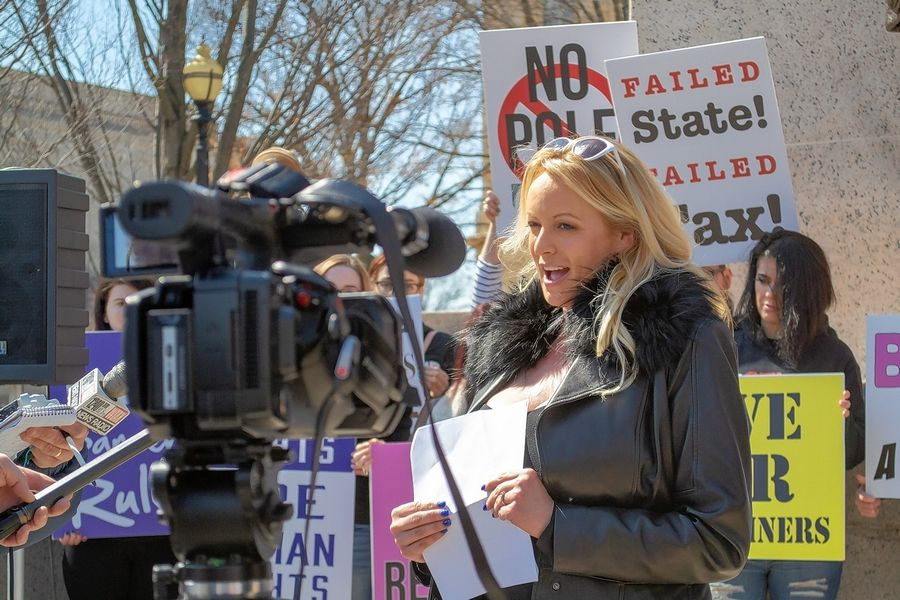 Adult film entertainer Stormy Daniels, whose real name is Stephanie Clifford, appeared at the Illinois Capitol on Friday, speaking for about two minutes against a six-year-old adult entertainment facilities tax, the proceeds of which support organizations that provide aid to victims of sexual assault. She said the tax unfairly links strip clubs to sexual assault and penalizes their customers with higher prices.