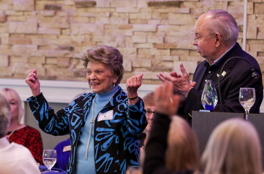 Helen Jerusis, 93, is volunteer of the year at Schaumburg's 32nd annual Volunteer of the Year Awards Luncheon on Monday for her work at the WINGS Resale Shop. Mayor Al Larson, right, looks on.